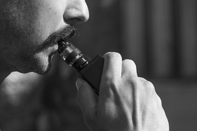 man-vaping-on-e-cigarette